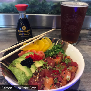 salmon and tuna poke bowl with a beer